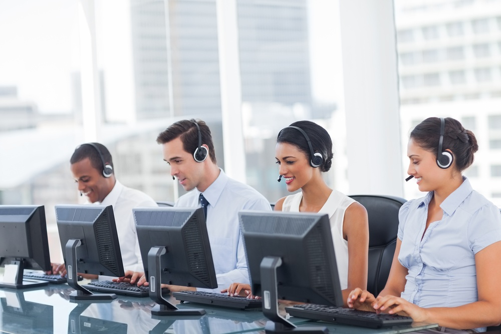 Line of call centre employees working on computers.jpeg
